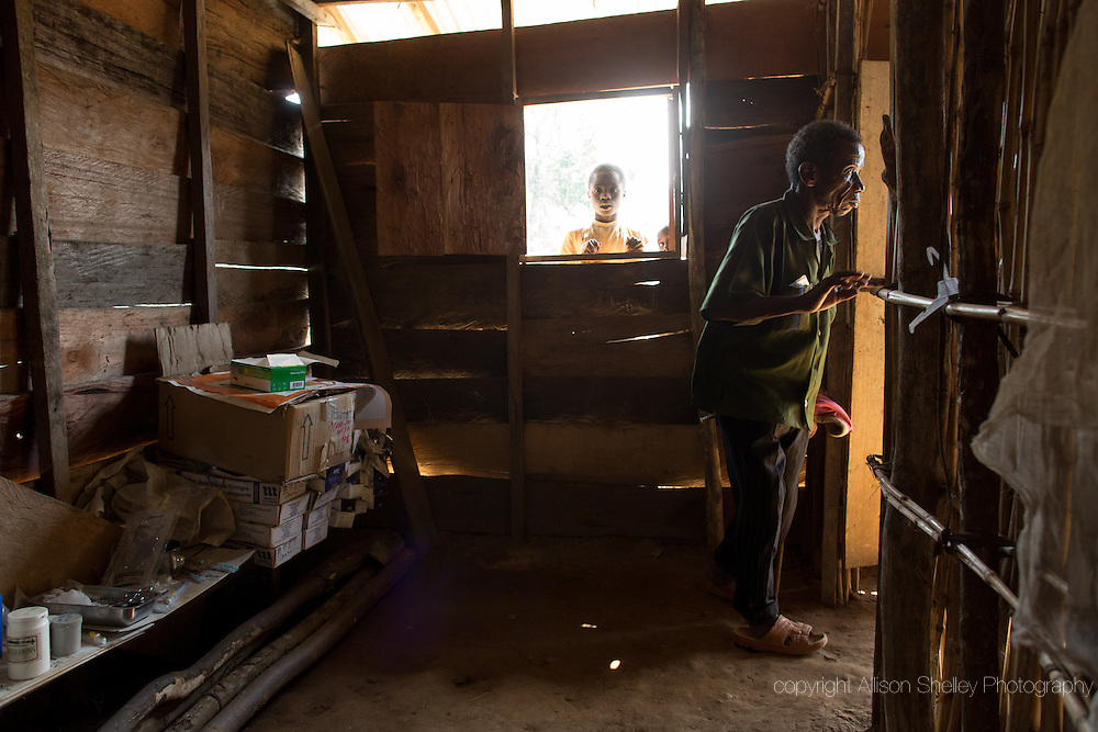 Boys peer through a window at the health post in Lushali, Masisi, North Kivu, Democratic Republic of Congo, July 30, 2014. The post was funded and built by the local community and staffed by government health workers who have never been paid their salaries.
