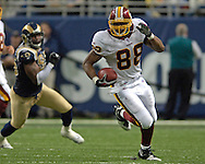 Washington Redskins tight end Robert Royal (R) rushes up field in the third quarter after making a catch for a first down against the St. Louis Rams, during the Redskins 24-9 win at the Edward Jones Dome in St. Louis, Missouri, December 4, 2005.