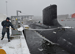 GROTON, Conn. (Feb. 8, 2013) Sailors assigned to the Virginia-class attack submarine USS Missouri (SSN 780) shovel the initial blanket of snow from their pier as a strong nor'easter arrives in Connecticut. (U.S. Navy photo by Mass Communication Specialist 1st Class Jason J. Perry/Released) 130208-N-TN558-016<br /> Join the conversation<br /> http://www.facebook.com/USNavy<br /> http://www.twitter.com/USNavy<br /> http://navylive.dodlive.mil