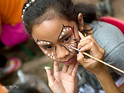 A girl has her face painted at the Women's International Group (WIG) bazaar, Vientiane, Lao PDR. The WIG Bazaar is a charity event aiming to raise funds for projects benefitting Lao women and children.