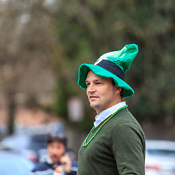 York, PA / USA - March 12, 2016: A man wears a green tall hat at the annual Saint Patrick's Day Parade.