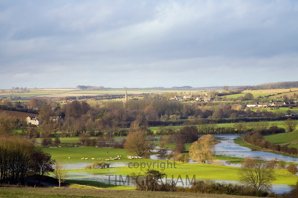 Windrush River and flooded water meadow in valley, The Cotswolds, United Kingdom