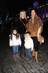 Left to right, CAROLINE HABIB and her daughter YASMIN HABIB,  GOGA ASHKENAZI and her son ADAM at Skate presented by Tiffany & Co at Somerset House, London on 22nd November 2010.