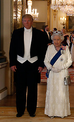 (left to right) US President Donald Trump and Queen Elizabeth II during a group photo ahead of the State Banquet at Buckingham Palace, London, on day one of US President Donald Trump's three day state visit to the UK.