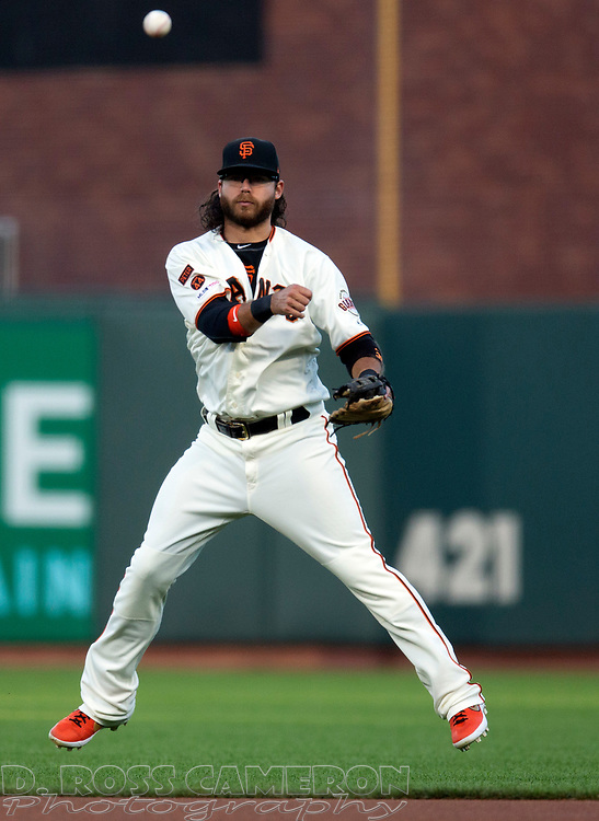 San Francisco Giants shortstop Brandon Crawford (35) leaves his feet to throw out San Diego Padres' Eric Hosmer at first base during the second inning of a baseball game, Thursday, Aug. 29, 2019, in San Francisco. (AP Photo/D. Ross Cameron)