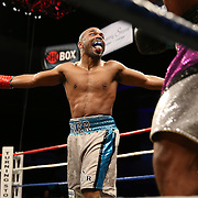 Middleweight Lanardo Tyner taunts Christopher Pearson (purple trunks) during Showtime Televisions ShoBox:The Next Generation boxing match at the Event Center at Turning Stone Resort Casino on Friday, February 28, 2014 in Verona, New York.  (AP Photo/Alex Menendez)