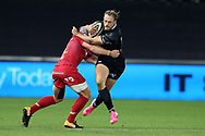 Cory Allen of the Ospreys is tackled by Jonathan Davies of the Scarlets. Guinness Pro14 rugby match, Ospreys v Scarlets at the Liberty Stadium in Swansea, South Wales on Saturday 7th October 2017.<br /> pic by Andrew Orchard, Andrew Orchard sports photography.