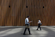 Japanese male office workers or salarymen wearing short sleeve shirts and no tie in the summer heat as part of the cool biz campaign. Tokyo International Forum, Yurakacho, Tokyo, Japan Thursday June 30th 2011