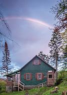 An autumn rainbow over the Hadsel-Mares cottage on Wheeler Pond.