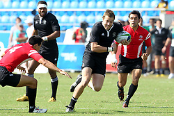 Tim Mikkelson of New Zealand attacks during the XIX Commonwealth Games 7s rugby match between New Zealand and Canada held at The Delhi University in New Delhi, India on the  11 October 2010..Photo by:  Ron Gaunt/photosport.co.nz