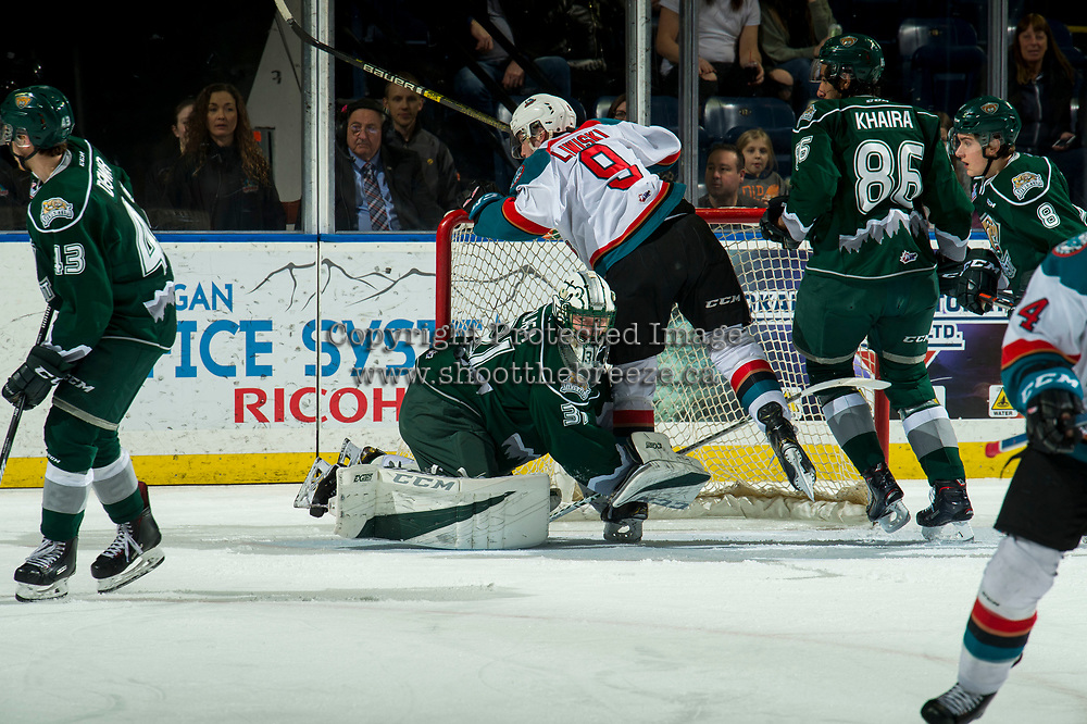 KELOWNA, CANADA - FEBRUARY 15:  Mark Liwiski #9 of the Kelowna Rockets falls over Max Palaga #31 of the Everett Silvertips during first period on February 15, 2019 at Prospera Place in Kelowna, British Columbia, Canada.  (Photo by Marissa Baecker/Shoot the Breeze)