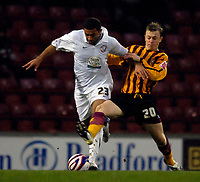 Photo: Jed Wee/Sportsbeat Images.<br /> Bradford City v Hereford United. Coca Cola League 2. 29/12/2007.<br /> <br /> Hereford's Simon Johnson (L) is tackled by Bradford's Scott Phelan.