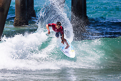 Keanu Asing (HAW) advances to Round 3 of the 2018 VANS US Open of Surfing after winning Heat 2 of Round 2 at Huntington Beach, California, USA.