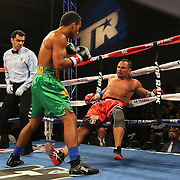 TAMPA, FL - FEBRUARY 28:  Esquiva Falcao (L) knocks down Mike Tufariello during the SoloBoxeo Tecate boxing match at the University of South Florida Sundome on February 28, 2015 in Tampa, Florida. Falcao won the bout by knockout.  (Photo by Alex Menendez/Getty Images) *** Local Caption *** Esquiva Falcao; Mike Tufariello