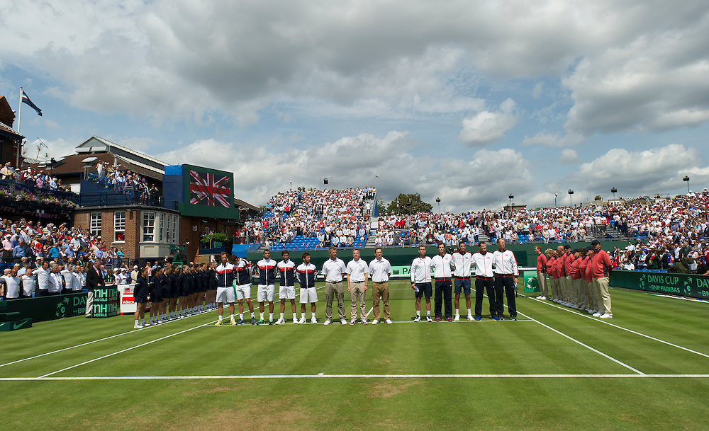 Both teams line up for the anthems <br /> <br /> Photographer Ashley Western/CameraSport<br /> <br /> International Tennis - 2015 Davis Cup by BNP PARIBAS - World Group Quarterfinals - Great Britain v France - Day 1 - Friday 17th July 2015 - Queens Club - London<br /> <br /> © CameraSport - 43 Linden Ave. Countesthorpe. Leicester. England. LE8 5PG - Tel: +44 (0) 116 277 4147 - admin@camerasport.com - www.camerasport.com.