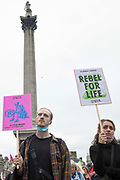 Environmental activists from Extinction Rebellion hold placards in Trafalgar Square during the first day of Impossible Rebellion protests on 23rd August 2021 in London, United Kingdom. Extinction Rebellion are calling on the UK government to cease all new fossil fuel investment with immediate effect.
