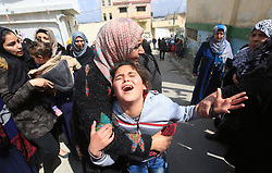 March 24, 2017 - Ramallah, West Bank - Relatives of Palestinian young man Mahmoud Hattab, 17, mourn during his funeral at the Jalazoun refugee camp. The Palestinian Health Ministry said Israeli soldiers killed the 17-year-old Palestinian and wounded another three. (Credit Image: © Xinhua via ZUMA Wire)