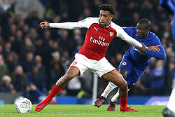 10 January 2018 - Football League Cup - Chelsea v Arsenal - Alex Iwobi of Arsenal stretches for the ball as he fends off N'Golo Kante of Chelsea - Photo: Charlotte Wilson / Offside