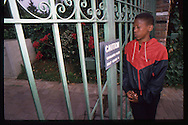 The OJ Simpson trial and media circus.<br /> A young boy stand out front of OJ Simpson's Brentwood home.