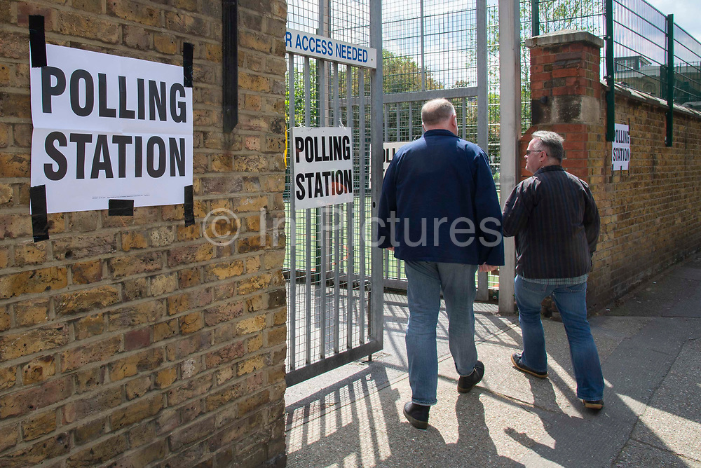 Two men arrive to cast their vote at a polling station on 23rd May 2019 in Greenwich ,South- East London, England, United Kingdom. Polls are open for the European Parliament elections. Voters will choose 73 MEPs in 12 multi-member regional constituencies in the UK with results announced once all EU nations have voted. The voting process expected to be completed by 10pm on Sunday.