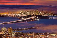 San Francisco city lights and fog over San Francisco Bay at sunset, California