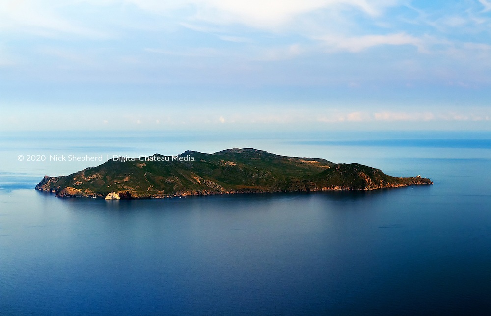 Italian island of Capraia in the Mediterranean Sea, near Corsica, in the morning light taken from the air.