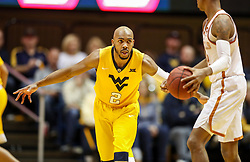 Jan 20, 2018; Morgantown, WV, USA; West Virginia Mountaineers guard Jevon Carter (2) defends a Texas Longhorns player during the second half at WVU Coliseum. Mandatory Credit: Ben Queen-USA TODAY Sports