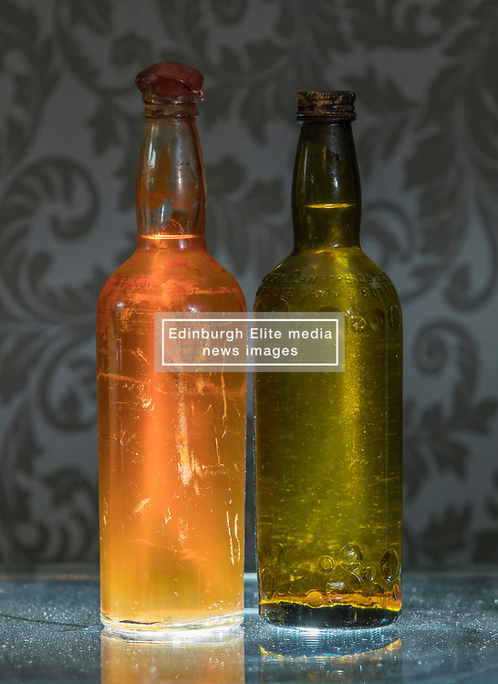 Bonhams whisky sale in Edinburgh on 7 June includes two salvaged bottles from the wreck of the SS Politician which were the inspiration for Compton MacKenzie's novel Whisky Galore. Also included in the sale is a 50 year-old Macallan Millennium Decanter distilled in January 1949.<br /> <br /> Pictured: Gilbey's - circa 1940 estimate £6,000 - £8,000 and Peter Dawson - circa 1940 estimate £4,000 - £6,000