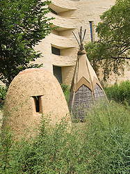 Washington DC; USA:  National Museum of the American Indian, inspiring new architecture on the Mall. Teepee and earthen oven on display..Photo copyright Lee Foster Photo # 12-washdc83298