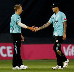 Surrey's Tom Curran with team-mate  Jade Dernbach<br /> <br /> Photographer Simon King/Replay Images<br /> <br /> Vitality Blast T20 - Round 14 - Glamorgan v Surrey - Friday 17th August 2018 - Sophia Gardens - Cardiff<br /> <br /> World Copyright © Replay Images . All rights reserved. info@replayimages.co.uk - http://replayimages.co.uk