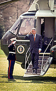 US President Bill Clinton walks off Marine One after returning to the White House from Camp David March 29, 1999 in Washington D.C.