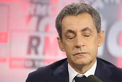 File photo - Exclusive - Nicolas Sarkozy is interviewed by Jean-Jacques Bourdin on RMC in Paris, France on October 27, 2016. A French judge has ordered ex-President Nicolas Sarkozy to stand trial in an illegal campaign finance case. Mr Sarkozy faces accusations that his party falsified accounts in order to hide 18m euros of campaign spending in 2012. Mr Sarkozy denies he was aware of the overspending, and will appeal against the order to stand trial. Photo by Jerome Domine/ABACAPRESS.COM