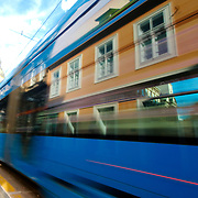 Lower old town of Zagreb reflected on a passing tram
