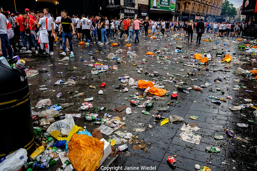 Broken bottles and beer cans that English Football fans threw  in Leicester Square central London before the finals of football match against Italy.  England v Italy Euro 2020 final. 11 July 2021