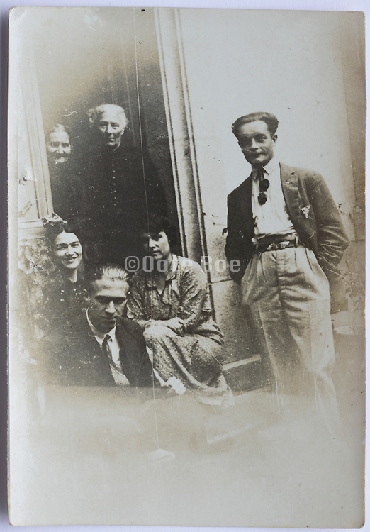 family posing in door opening France