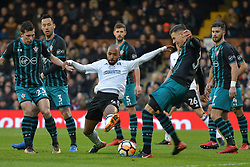 January 6, 2018 - Fulham, England, United Kingdom - Fulham defender Denis Odoi is surrounded by Southampton players during the FA Cup 3rd Round match between Fulham against Southampton  at Craven Cottage Stadium, London England on 06 Jan 2018. (Credit Image: © Kieran Galvin/NurPhoto via ZUMA Press)