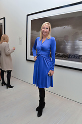 TANIA BRYER at a private view of photographs by wildlife photographer David Yarrow included in his book 'Encounter' held at The Saatchi Gallery, Duke of York's HQ, King's Road, London on 13th November 2013.