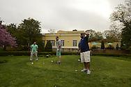 Town of Oyster Bay Golf Course, Woodbury, NY - Public golf course on Long Island's Gold Coast mid Spring. [Assistant Greenskeeper JAMES PANCIROLI. 12th hole (young men) Marc Ochs, Syosset - grey short sleeve shirt; green shorts John Beers - Syosset - blue shirt; khaki shorts Mark Luccarelli, Syosset - beard, green shirt, light pants Robert Nuzzolese, Syosset, navy blue top, light shorts 16th hole (gray hair) Arthur Gralitzer, Jericho - black jacket over white shirt; black shorts Gary Castle, Jericho - sunglasses, black short sleeve shirt; light pants]