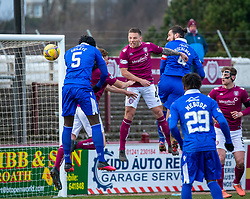 06MAR21 Queen of the South's Ayo Obileye scoring their first goal. Arbroath 2 v 4 Queen of the South, Scottish Championship played 6/3/2021 at Arbroath's home ground, Gayfield Park.