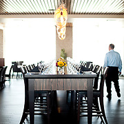 The dining room of Orange Sky at Talking Stick Resort in Scottsdale, offers not only amazing sunset views, but a modern decor and an impressive community table. ..Photograph by Jill Richards.www.jillrichardsphotography.com