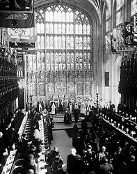 File photo dated 06/02/52 of the coffin of King George VI being lowered into the vault during his funeral at St. George's Chapel. Windsor Castle has been the setting for many funerals for the British monarchy, with the Duke of Edinburgh's service to be the first in 16 years. Issue date: Friday April 16, 2021.