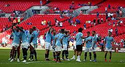 Manchester City'€™s Sergio Aguero (centre) with teammates at full time