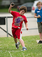 """Jericho Mason of Woodland Heights throws a 26' 11"""" shot put during the 5th grade track meet with Elm Street, Pleasant Street and Woodland Heights Elementary School students Wednesday morning at Opechee Park.  (Karen Bobotas/for the Laconia Daily Sun)"""
