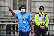 """A Cameroonian-British nurse, gestures as she protests in Whitehall, nearby Downing Street prior to French President Emanuel Macron's visit in London, on Thursday, June 18, 2020. They say France is involved in the looting of Cameroon and Africa. A letter addressing the press and members of the public says: """"We are here to tell Mr Macron this is unacceptable. Enough is enough!"""".<br /> For his first foreign trip since lockdown, Emmanuel Macron will be in London to mark the 80th anniversary of de Gaulle's « appel de Londres », as well as cement Franco-UK ties at a strained time due to Brexit. (Photo/ Vudi Xhymshiti)"""