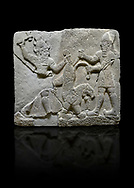 Photo of Hittite relief sculpted orthostat stone panel of Herald's Wall Basalt, Karkamıs, (Kargamıs), Carchemish (Karkemish), 900-700 B.C. Anatolian Civilisations Museum, Ankara, Turkey.<br /> <br /> On the right is a bearded human figure with a short skirt; with the dagger in his right hand, he is stabbing the lion standing on his front legs while holding the lion's tail with his left hand. On the left is a bearded god figure with a horned-headdress, who grasps the lion's hind leg while holding the ax over his head with his right hand. <br /> <br /> Against a black background. .<br />  <br /> If you prefer to buy from our ALAMY STOCK LIBRARY page at https://www.alamy.com/portfolio/paul-williams-funkystock/hittite-art-antiquities.html  - Type  Karkamıs in LOWER SEARCH WITHIN GALLERY box. Refine search by adding background colour, place, museum etc.<br /> <br /> Visit our HITTITE PHOTO COLLECTIONS for more photos to download or buy as wall art prints https://funkystock.photoshelter.com/gallery-collection/The-Hittites-Art-Artefacts-Antiquities-Historic-Sites-Pictures-Images-of/C0000NUBSMhSc3Oo