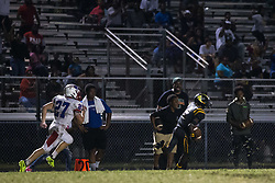 October 6, 2017 - Florida, U.S. - LOREN ELLIOTT   |   Times .Lakewood's Troyvon Johnson comes down with an interception and returns it for a touchdown as Pinellas Park receiver Ethan Blanchard chases during the second half of a game between Pinellas Park and Lakewood at Lakewood High in St. Petersburg, Fla., on Friday, Oct. 6, 2017. (Credit Image: © Loren Elliott/Tampa Bay Times via ZUMA Wire)