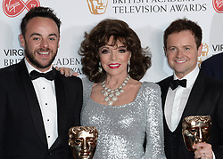 Joan Collins presents Ant McPartlin and Declan Donnelly with the award for Best Entertainment Programme in the winners photo area at the Virgin British Academy Television Awards (BAFTA) held at the Royal Festival Hall, Southbank, London. Photo credit should read: Doug Peters/ EMPICS Entertainment