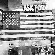 American flag painted onto window of auto shop