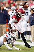 Arkansas running back Alex Collins (3) is brought down by Auburn defensive back Ryan Smith (24) as defensive back Jermaine Whitehead (9) looks on during an NCAA college football game in Fayetteville, Ark., Saturday, Nov. 2, 2013. Auburn defeated Arkansas 35-17. (AP Photo/Beth Hall)