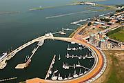 Nederland, Flevoland, Lelystad, 22-05-2011;.Zicht op jachthaven, Bataviahaven en Houtribsluizen en Houtribdijk in de achtergrond bij Lelystad. De replica van het  VOC-schip (rechtsboven) ligt naast Batavia Stad (eerste fashion oulet of 'Factory Outlet Center). View at marina, Bataviahaven and Houtribdijk at Lelystad..luchtfoto (toeslag), aerial photo (additional fee required).foto/photo Siebe Swart